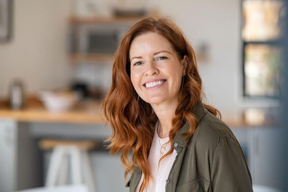 smiling woman with long red hair